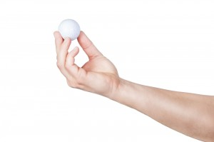 The golf-ball exercise is an easy way to get a $100 hand/foot reflexology treatment for less than one dollar.